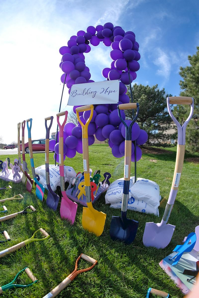 Cancer support ribbons and multi colored shovels